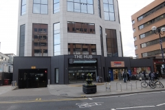 23 The Hub building exterior with car park Harrow serviced apartments